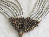A fine old  afi�afi�oiya eight strand shell money necklace with fish teeth inset in the centre, Malaita, Solomon Islands.