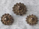Three Dayak white metal ear studs.