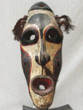 Dynamic old mask for a canoe prow shield, Middle Sepik..